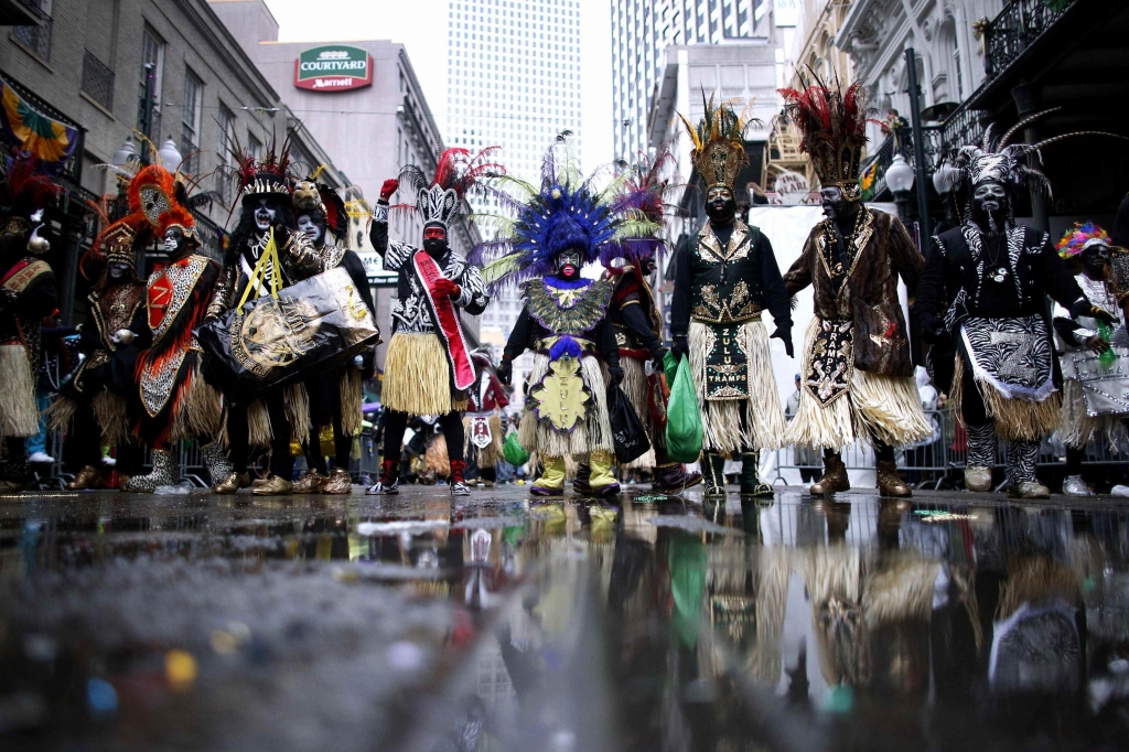 Members of the Krewe of Zulu parade down St. Charles Avenue on Mardi Gras Day in New Orleans